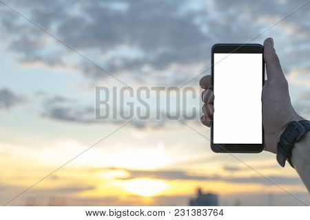 Man Holding Smartphone At The Sunset With Isolated White Screen. Empty Space For Text. Isolated Scre
