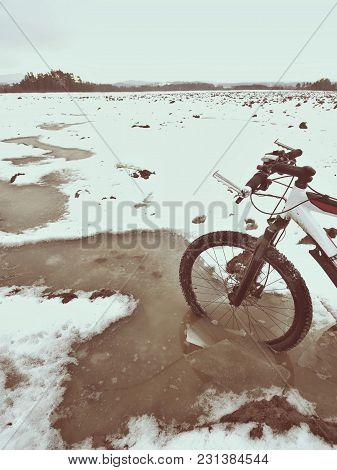Mountain Bike Wheel Broke Through The Ice Into The Water. Enjoy Winter Biking With Fun