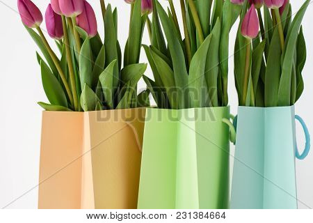 Bouquets Of Tulips In Paper Multi-colored Packages. Spring Gifts.
