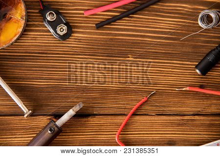 Set For Soldering Wire And Shrink Soldering Tube With Solder Next To Screwdriver On A Wooden Backgro