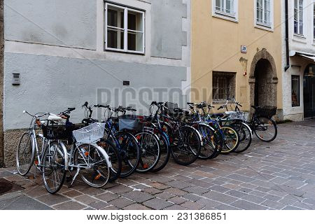 Salzburg, Austria - August 6, 2017: Bicycles Parked In Picturesque Street In Historic City Centre Of