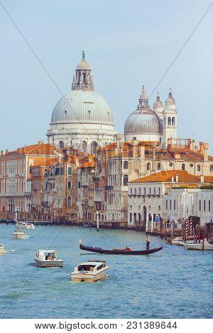 Basilica Santa Maria Della Salute, Venice, Italy. Landscape Grand Canal With Gondolas And Boats.