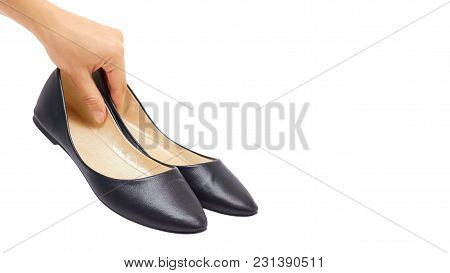 Hand Of A Woman Holding Shoes Isolated On White Background. Copy Space, Template.