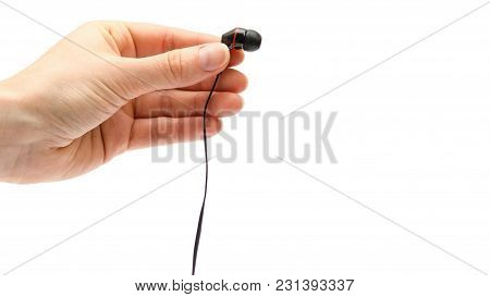 Hand Of Young Girl Holding Earphones. Isolated On White Background. Copy Space, Template