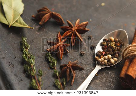 Three Metal Spoons With Different Spices On Dark Old Table Or Background. Dark Moody Photo. Horizont
