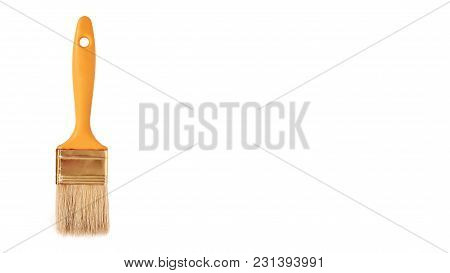 Orange Paint Brush Isolated On White Background. Copy Space, Template.