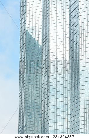 Business Abstract - Modern Office Building Covered With Glass Against Blue Sky. Copy Space. Details