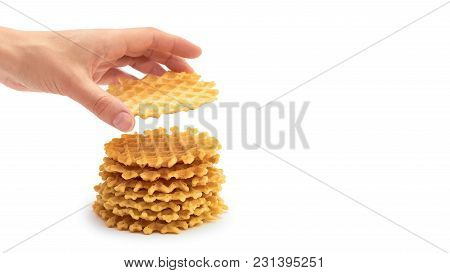 Female Hand Holds Homemade Crisp Waffle. Isolated On White Background. Copy Space, Template.