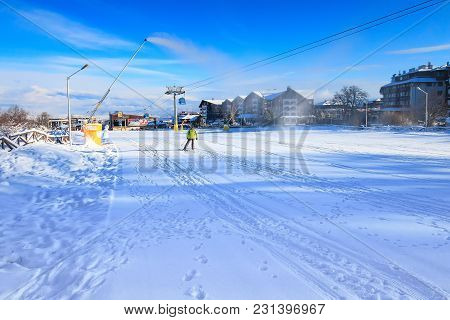 Bansko, Bulgaria - January 22, 2018: Winter Ski Resort Bansko With Ski Slope, Lift Cabins, People An