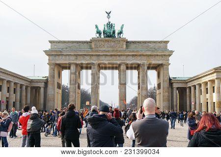 Berlin, Germany - March 10, 2018: Tourist Crowd On Pariser Platz In Front Of Brandenburg Gate
