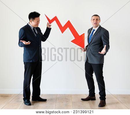 Businessmen with  decreasing symbol
