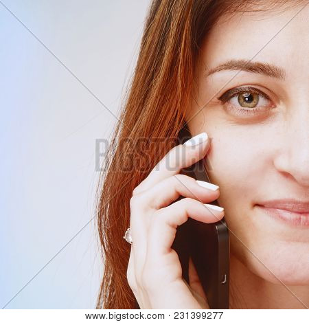 Portrait Of Beautiful Happy Lovely Woman Laughs, Smiles And Speaks On Mobile Phone. Love And Positiv