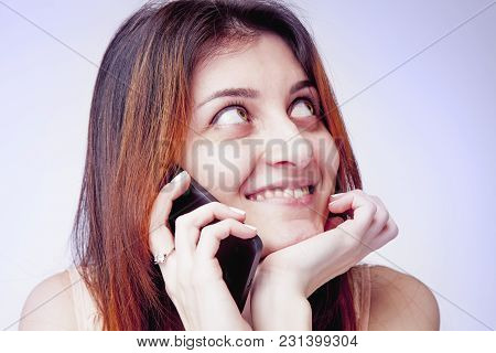 Happy Lovely Young Woman Speaking On Mobile Phone. Love And Positive Emotion Concept.