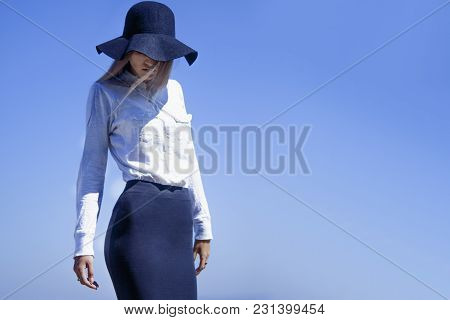 Summer Trips. Young Woman Standing On A  Mountain Road  And Is Ready For Summer Vacation.