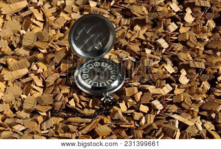Old Pocket Mechanical Watch With Chain On Wood Chips