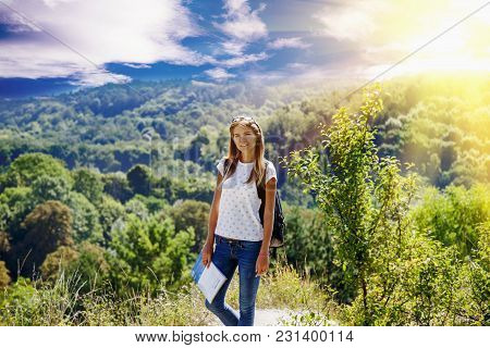 Happy Young Woman Standing On Top Of Mountain And Enjoys View Of Mountains. (travel, Nature, Adventu