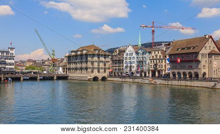 Zurich, Switzerland - 24 April, 2014: Buildings Of The Old Town Of The City Of Zurich Along The Limm