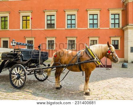 Warsaw, Poland - June 29, 2013: Warsaw Old City. Horse-drawn Vehicles Expect Passengers In The Old T