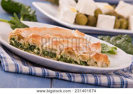 Spanakopita Greek Spinach Pie On White Dish.