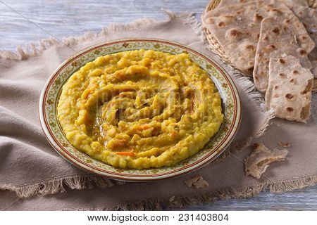 Stewed Yellow Peas With Carrots, Onions And Spices On A Wooden Table With Chapatti, Selective Focus