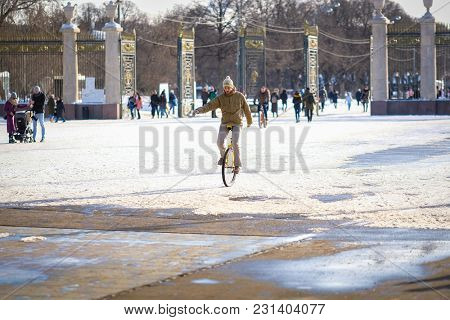 Moscow, Russia - March, 11, 2018: young man rides a one-wheeled bike