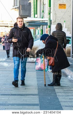 Moscow, Russia - March, 10, 2018: begger stands on Moscow stree