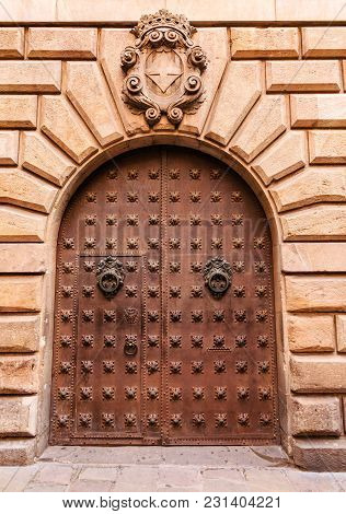 Iron Knockers And Trim On Old Wood Door In Barcelona