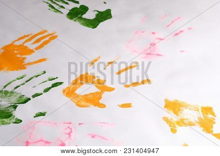 Prints Of Children's Hands Left With Different Colors On White Paper, Children's Creativity