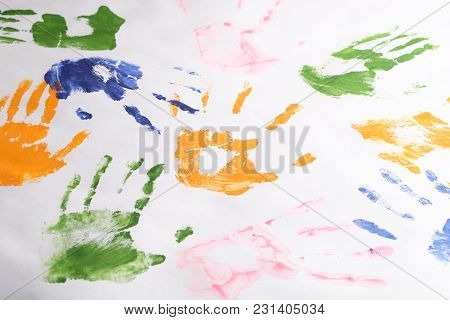 Set Of Handprints Of Children Left With Colorful Paints On A White Background