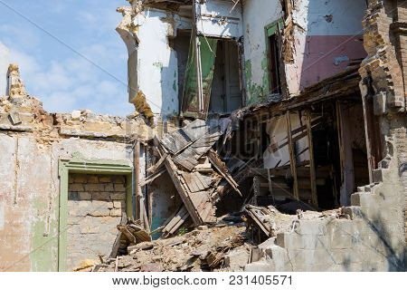 Destroyed Houses And Ruins, Chaos And Deserted Village Due To The War In Eastern Ukraine.
