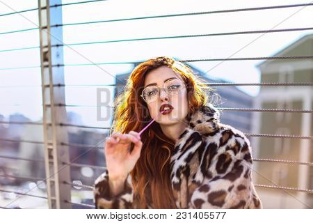 Fashionable teenager with chewing gum