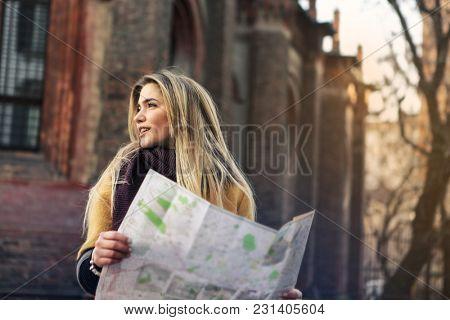Tourist using a map