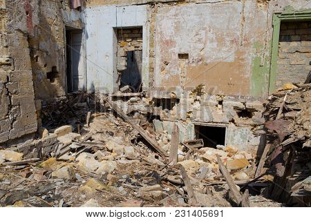 Concept Of The Fighting Force And War. Ruins Of House, War. Abandoned And Devastated Building In Ukr
