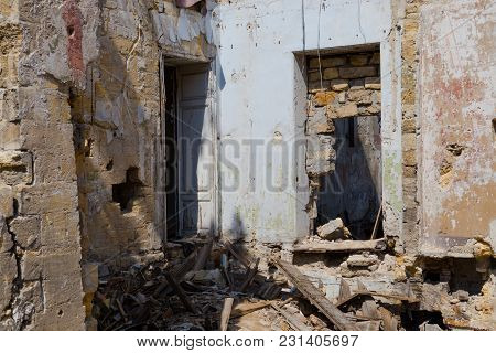 Ruined House Building After Disaster, War. Ruins Of House, War. Abandoned And Devastated Building In