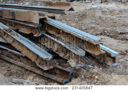 Cut Rails On Ground. Railway Repair. Process Of Installation Of New Railway For Train. Repair And Re