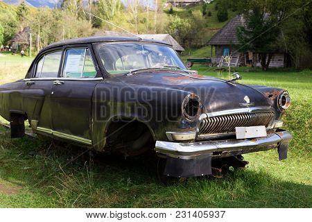 Kolochava, Ukraine - Circa Oct 2017: Old Volga Car Black Color, Produced In The Soviet Union, Stands