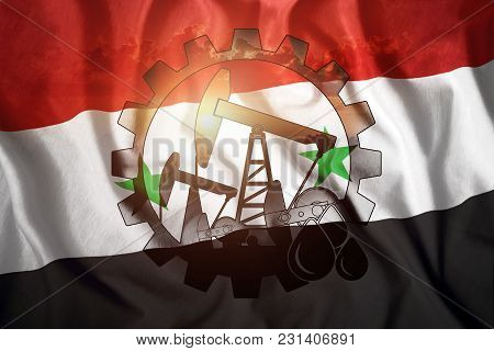 Oil Rig On The Background Of The Flag Of Syria. Mixed Environment. The Concept Of Oil Production, Mi