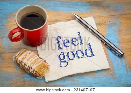 feel good - handwriting on a napkin with a cup of coffee and cookie