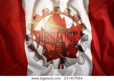 Oil Rig On The Background Of The Flag Of Canada. Mixed Environment. The Concept Of Oil Production, M