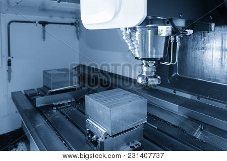 The Cnc Milling Machine Cutting The Raw Material By The Face Milling Tool.