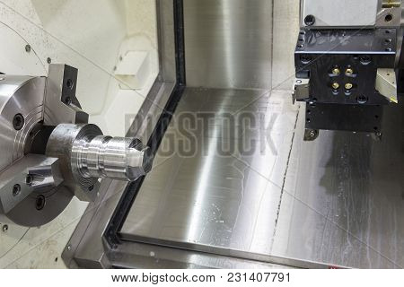 The Abstract Scene Of Cnc Lathe Machine And Metal Part With Lighting Effect.