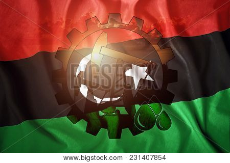 Oil Rig On The Background Of The Flag Of Libya. Mixed Environment. The Concept Of Oil Production, Mi