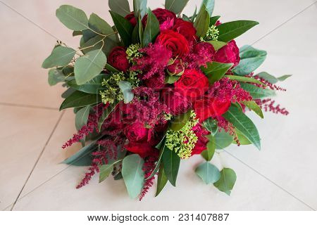 Wedding. Lush Bridal Bouquet Of Red Roses And A Lot Of Greenery