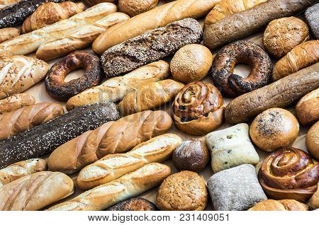 Freshly Baked Bread And Bakery Products. Background Of Bread