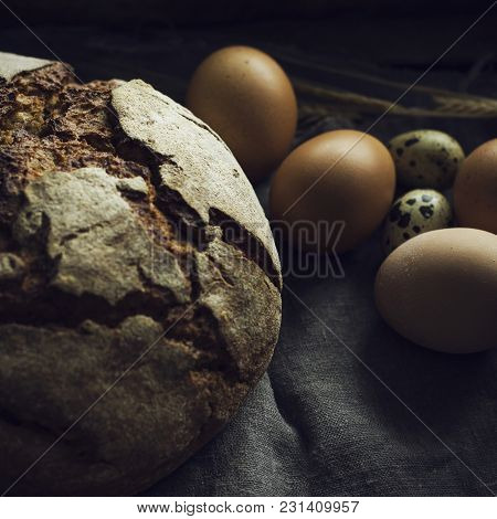 Loaf Of Rye Bread With Chicken Eggs, Selective Focus
