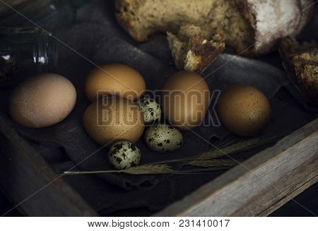 Loaf Of Rye Bread With Chicken Eggs In Wooden Box