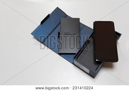 Belgrade, Serbia - March 13, 2018: Newly Launched Samsung Galaxy S9 Smartphone Unpacking On White Ba