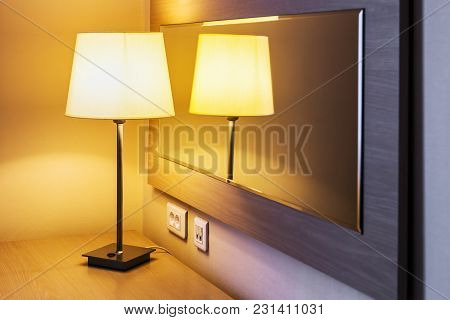 Table Lamp In The Room Or Hotel Room On The Background Is Reflected In The Mirror