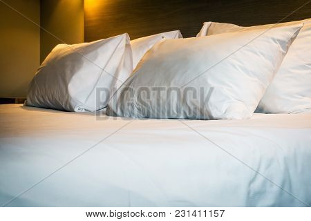 Pillows On A Large King-size Bed. Concept On Preparation Of The Bed In A Hotel Room Or At Home