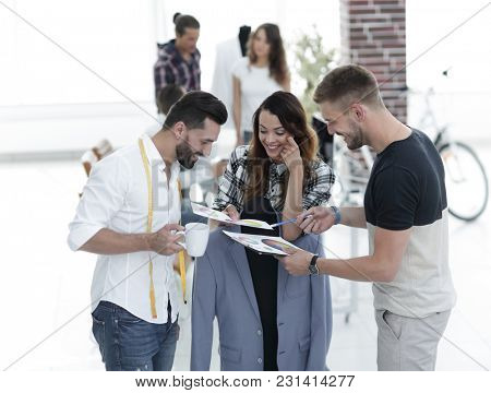 designers discussing the design of the male suit